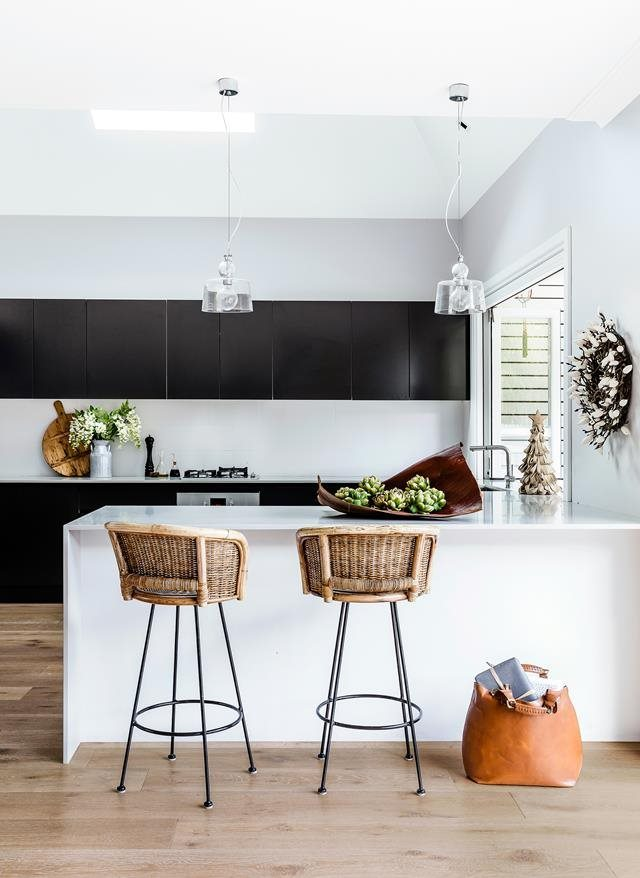 Casual understated elegance and a black kitchen- Perfect!