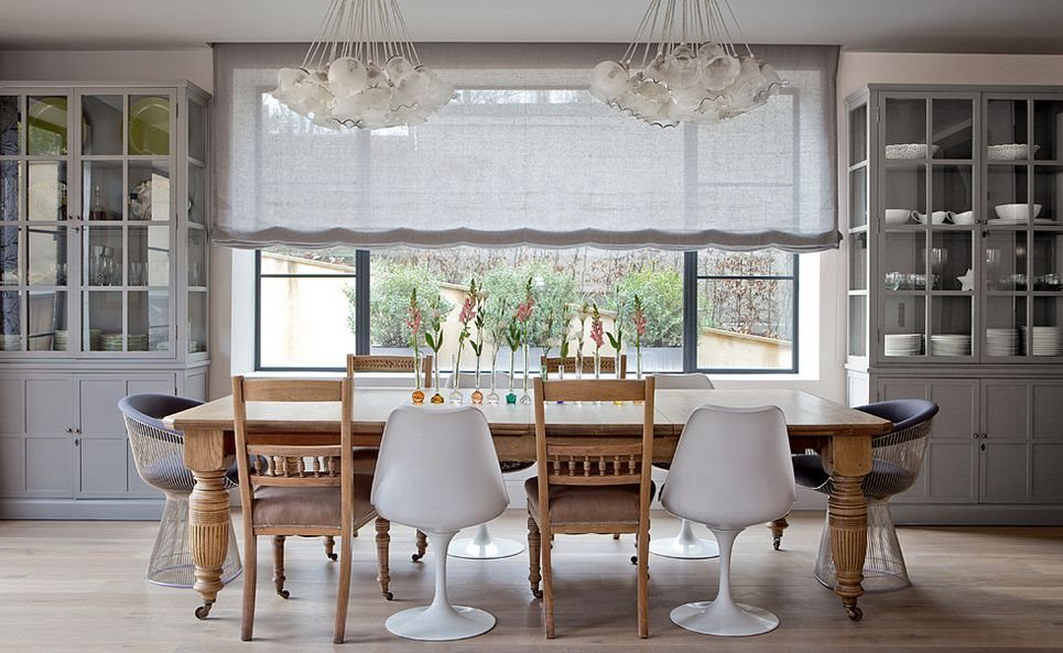 large-rectangular-dining-table-with-saarinen-tulip-armchairs-and-classic-chairs