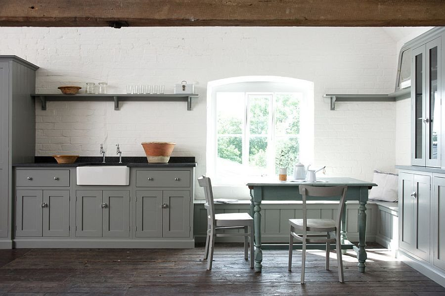 Unassuming-kitchen-with-gray-cabinets-and-a-whitewashed-brick-wall