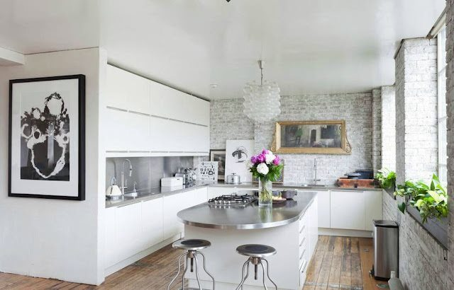 cococozy-kitchen-exposed-brick-white-washed-stainless-steel-counters-countertops-white-cabinets-cabinetry-curved-counter