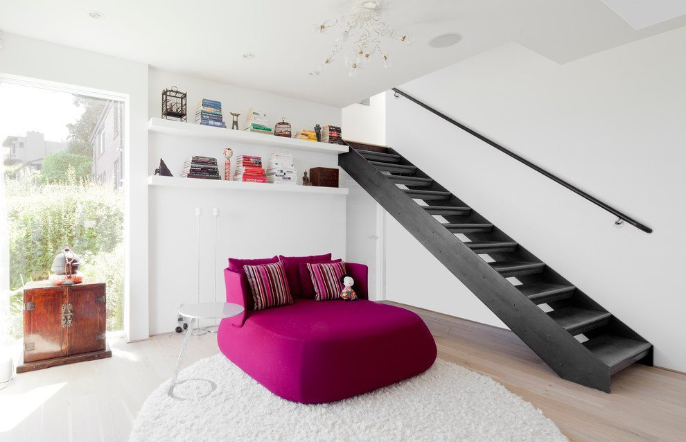 excellent-pink-chaise-lounge-in-contemporary-family-room-with-white-round-area-rug-next-to-pink-chaise-lounge-alongside-with-floating-shelves