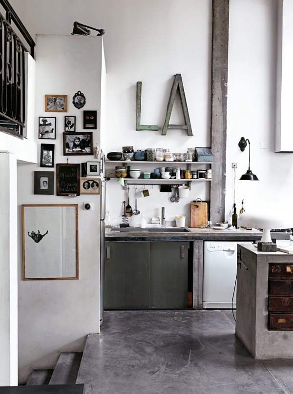It is no secret that i am a big fan of concrete and this kitchen is a perfect example of why i like it so much- it creates an industrial raw image that is the perfect backdrop for a kitchen full of personal items, pictures and momento's without looking too cluttered