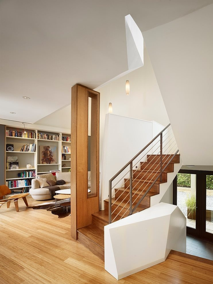 wooden-stair-with-white-wall-and-steel-handrail-in-minimalist-prefab-house-design